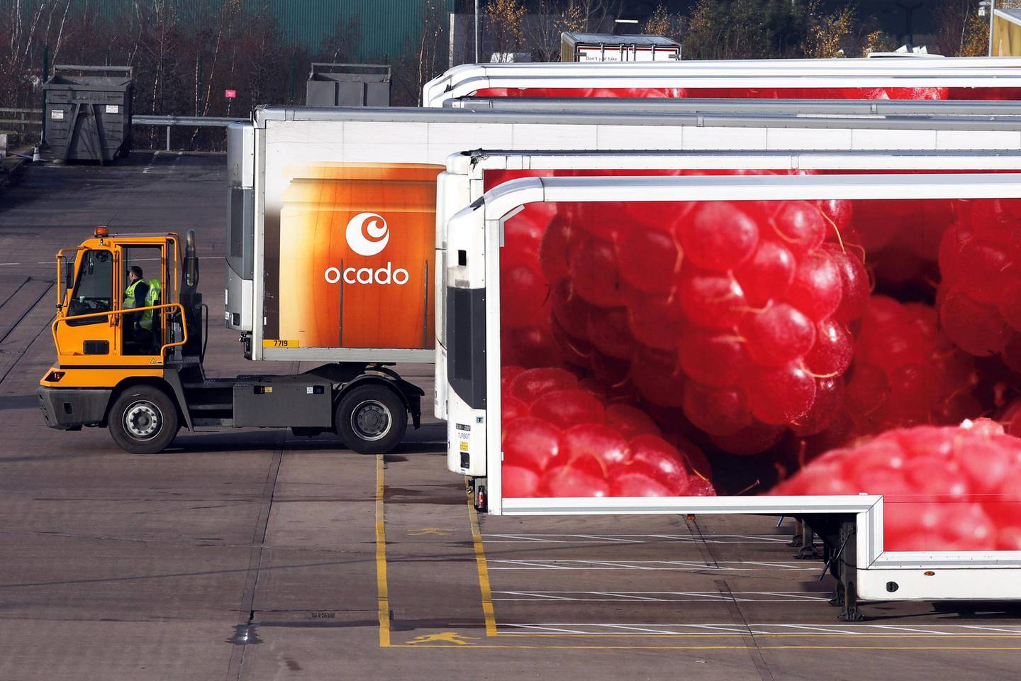 A truck pushes an articulated lorry trailer into position at the Ocado Group Plc distribution centre in Dordon, U.K., on Friday, Dec. 16, 2016. Ocado provides home delivery of a wide range of products including food and drink, toiletries and baby, household, pet care, and holiday products.  Photographer: Chris Ratcliffe/Bloomberg