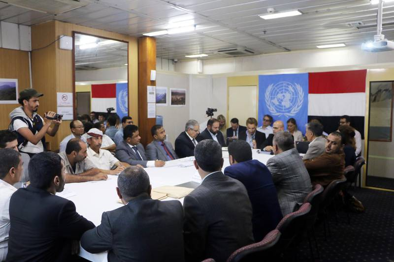 epa07828262 Negotiators from Yemen's government (L) and Houthi rebels (R) hold UN-mediated peace talks aboard a UN ship in the Red Sea off the coast of the city of Hodeidah, Yemen 08 September 2019. According to reports, negotiators from Yemen's internationally recognized government and the Houthi rebels  have resumed UN-mediated peace talks aboard a UN ship in the Red Sea off Yemeni coast to discuss strengthening a ceasefire deal and activating a new procedure for de-escalation in Hodeidah.  EPA/STRINGER