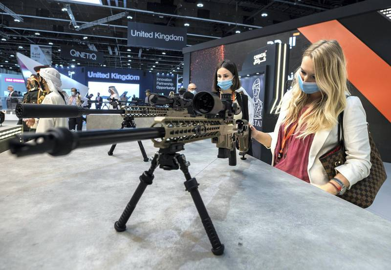 Abu Dhabi, United Arab Emirates, February 21, 2021.  Idex 2021, the first major in-person exhibition held in Abu Dhabi since the start of the Covid-19 pandemic, opened its doors to delegates on Sunday morning.  Visitors look at some UAE firepower by Caracal International LLC.Victor Besa / The NationalSection:  NAReporter:  John Dennehy