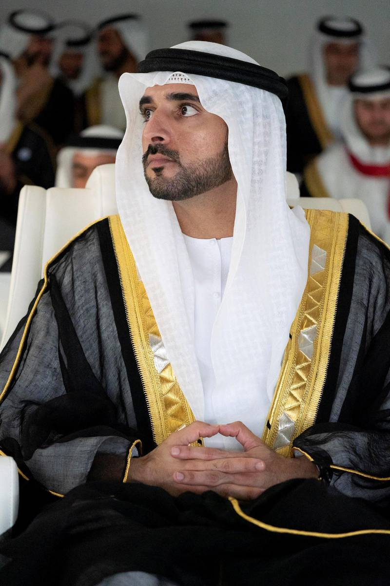 ABU DHABI, UNITED ARAB EMIRATES - December 02, 2018: HH Sheikh Hamdan bin Mohamed Al Maktoum, Crown Prince of Dubai, watches a performance of 'This is Zayed, This is UAE' during the 47th UAE National Day celebrations, at Zayed Sports City.  ( Mohamed Al Hammadi / Ministry of Presidential Affairs ) ---