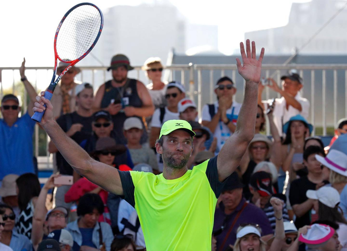 Croatia's Ivo Karlovic celebrates after winning over Japan's Yuichi Sugita during their second round match at the Australian Open tennis championships in Melbourne, Australia, Wednesday, Jan. 17, 2018. (AP Photo/Ng Han Guan)