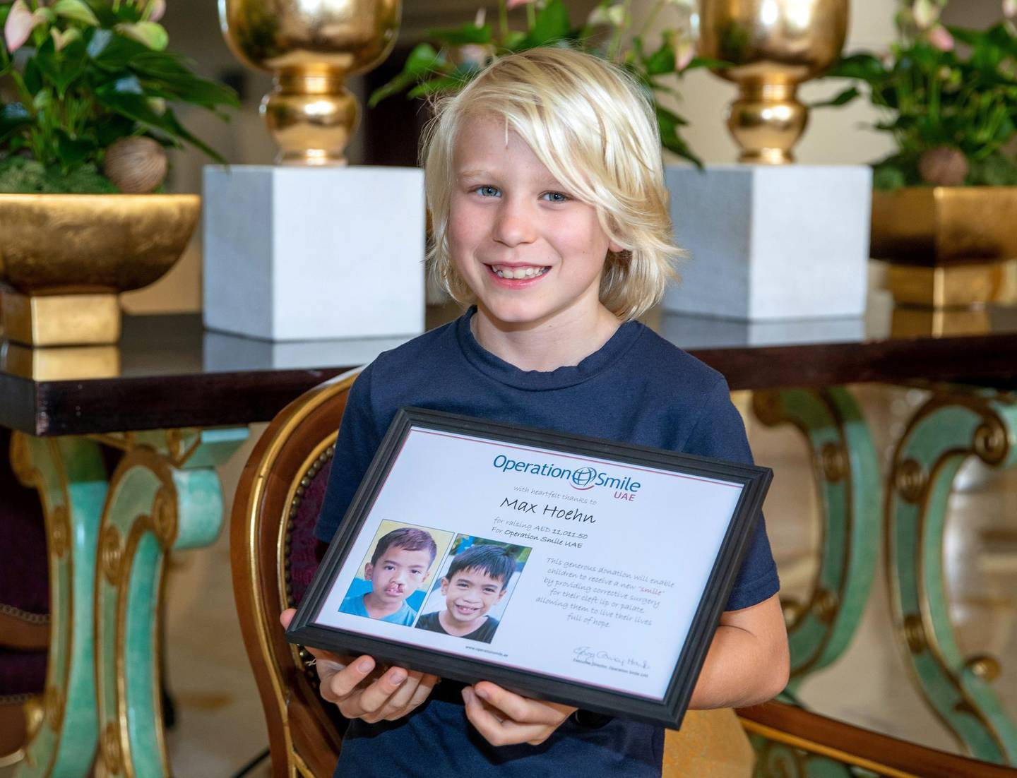 Abu Dhabi, United Arab Emirates, March 9, 2021.  Maximillian Hoehn 10 year old raises Dh11,000 for UAE charity, Operation Smile. Max with an appreciation plaque from Operation Smile UAE.Victor Besa/The NationalSection:  NAReporter:  Sarwat Nasir