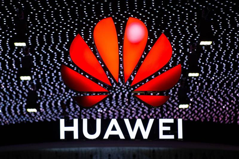 BARCELONA, SPAIN - FEBRUARY 26:  A logo sits illumintated outside the Huawei booth on day 2 of the GSMA Mobile World Congress 2019 on February 26, 2019 in Barcelona, Spain. The annual Mobile World Congress hosts some of the world's largest communications companies, with many unveiling their latest phones and wearables gadgets like foldable screens and the introduction of the 5G wireless networks. (Photo by David Ramos/Getty Images)