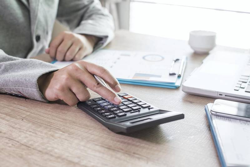 The calculators, business owners, accounting and technology, business, computer, laptop, calculator and documents in the office.