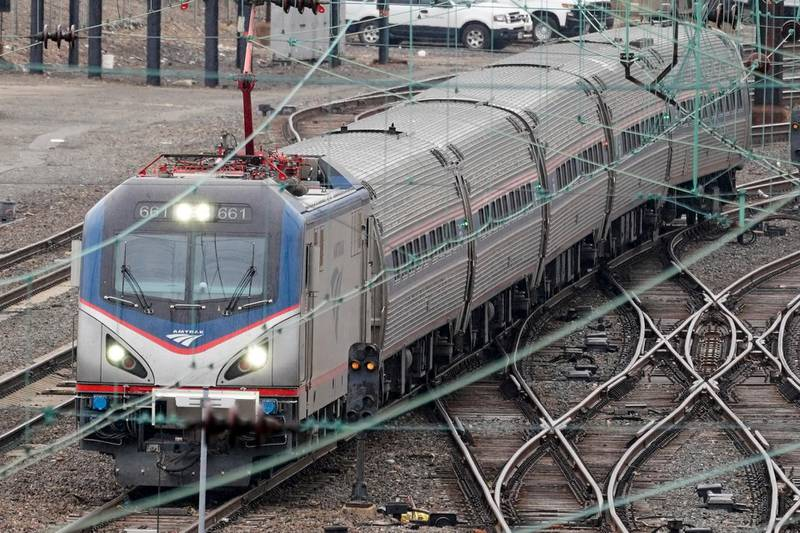 An Amtrak train departs 30th Street Station in Philadelphia, Wednesday, March 31, 2021. Looking beyond the $1.9 trillion COVID relief bill, President Joe Biden and lawmakers are laying the groundwork for another of his top legislative priorities — a long-sought boost to the nation's roads, bridges and other infrastructure that could meet GOP resistance to a hefty price tag. (AP Photo/Matt Rourke)