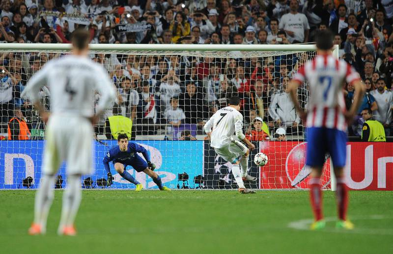 Cristiano Ronaldo of Real Madrid scores his side's fourth goal from the penalty spot (Photo by Chris Brunskill Ltd/Corbis via Getty Images)
