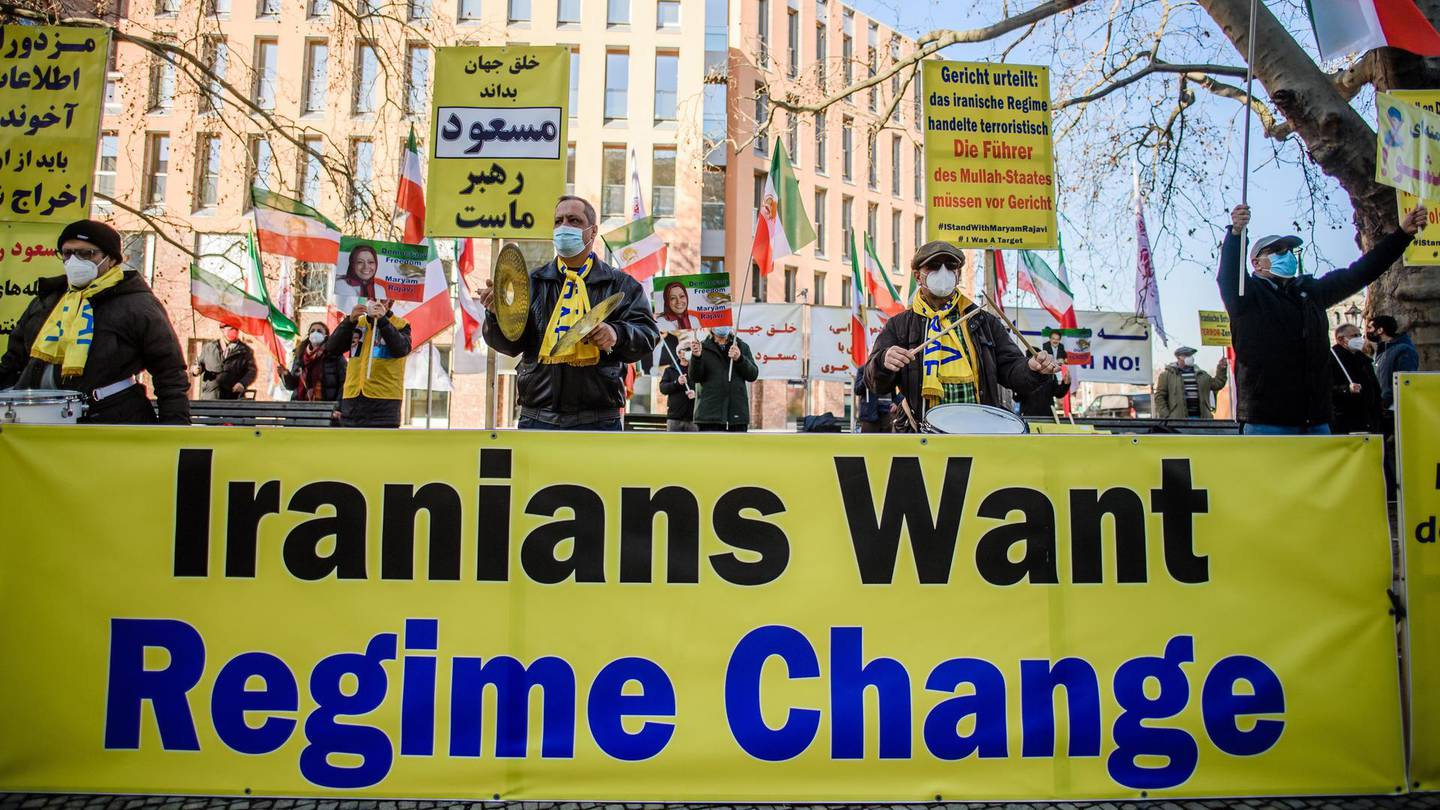 epa09029581 Protesters against the Iranian government, demonstrate with a banner reading 'Iranians want regime change' in front of the Foreign Ministry in Berlin, Germany, 22 February 2021. On the occasion of a EU Foreign Ministers meeting in Brussels on 22 February, protesters of the National Council of Resistance of Iran and the German-Iranian Society gathered in front of the German Foreign Ministry, to demonstrate against alleged Iranian terror allegedly executed by Iranian diplomats.  EPA/CLEMENS BILAN
