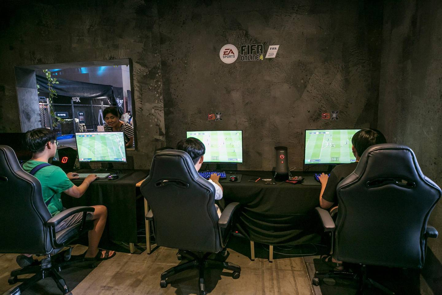 Gamers play the FIFA Online 4 game, developed by Electronic Arts Inc. (EA), during SK Telecom Co.'s 5GX Game Festival in Goyang, South Korea, on Friday, Aug. 10, 2018. Professional video gaming began in South Korea more than a decade ago, and has given rise to leagues that now pack stadiums and draw hundreds of thousands of eyeballs toTwitch livestreamsfor tournaments. Photographer: Jean Chung/Bloomberg