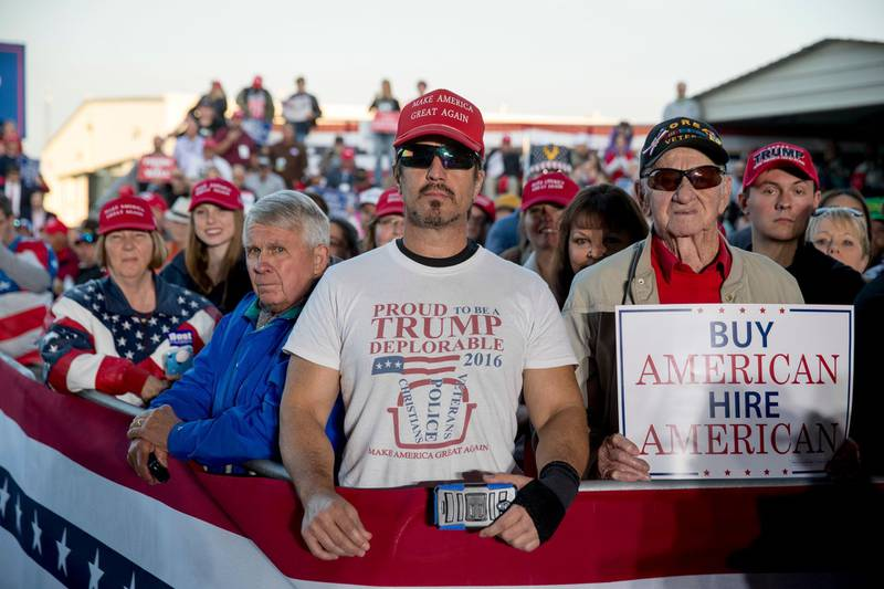 """A member of the audience wears a shirt that reads """"Proud to Be A Trump Deplorable"""" as President Donald Trump speaks at a rally at Southern Illinois Airport in Murphysboro, Ill., Saturday, Oct. 27, 2018. (AP Photo/Andrew Harnik)"""