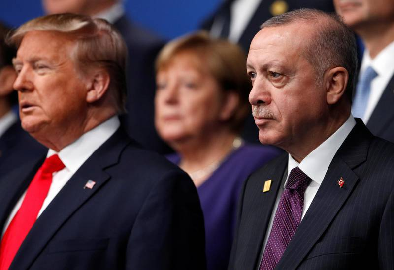 U.S. President Donald Trump and Turkey's President Tayyip Erdogan pose for a family photo during the annual NATO heads of government summit at the Grove Hotel in Watford, Britain December 4, 2019.  REUTERS/Peter Nicholls/Pool