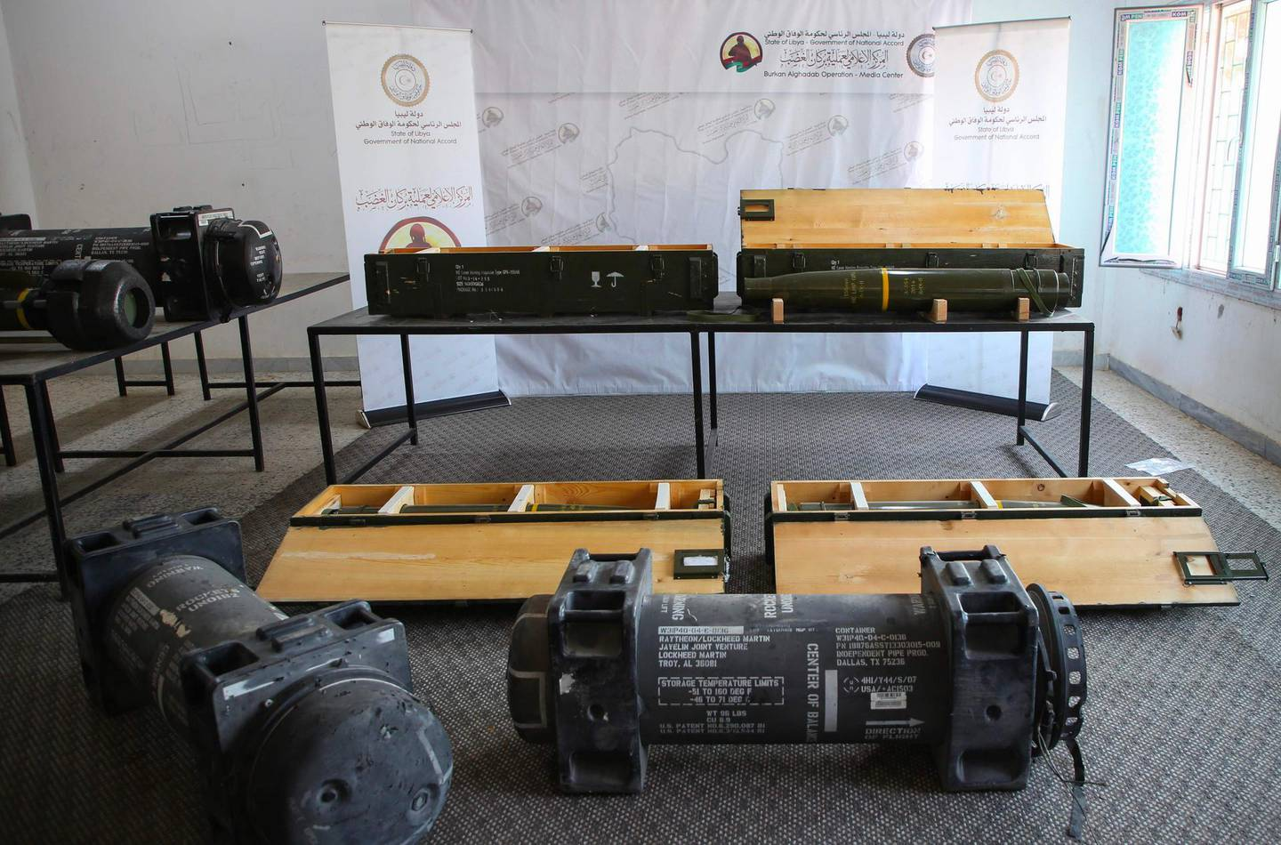 A picture taken in Tripoli on June 29, 2019, shows fighters loyal to the internationally-recognised Libyan Government of National Accord (GNA) displaying US-made Javelin anti-tank missile and precision guided munition, which were reportedly confiscated from forces loyal to General Khalifa Haftar in Gharyan. The United States said it was looking into a report that American anti-tank missiles were found by forces loyal to Libya's unity government at a captured rebel base. The missiles were apparently discovered earlier this week when forces loyal to the Government of National Accord recaptured the strategic town of Gharyan in a surprise attack, seizing the main supply base for Haftar's Tripoli offensive. / AFP / -