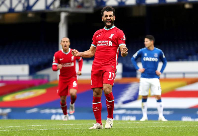 LIVERPOOL, ENGLAND - OCTOBER 17: Mohamed Salah of Liverpool celebrates after scoring his team's second goal during the Premier League match between Everton and Liverpool at Goodison Park on October 17, 2020 in Liverpool, England. Sporting stadiums around the UK remain under strict restrictions due to the Coronavirus Pandemic as Government social distancing laws prohibit fans inside venues resulting in games being played behind closed doors. (Photo by Catherine Ivill/Getty Images)
