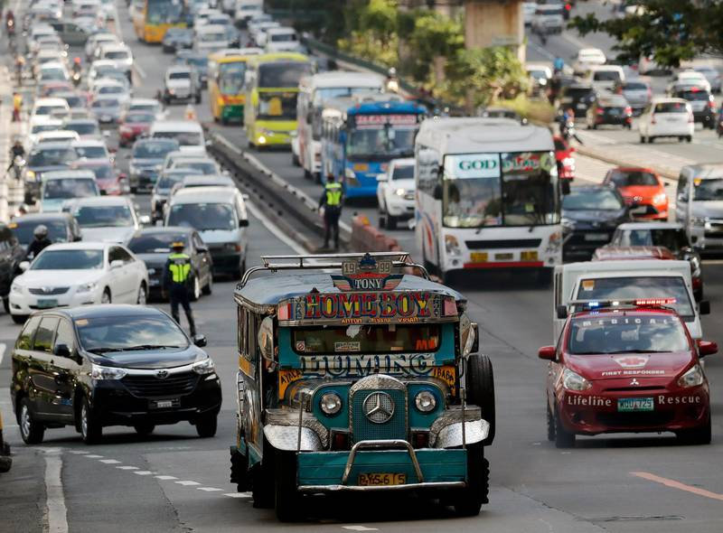 epa06622264 A jeepney, a popular and uniquely Filipino mode of mass transport, maneuvers amid heavy traffic in Makati city, south of Manila, Philippines, 23 March 2018, one day ahead of the day designated as Earth Hour. Earth Hour is an annual event in which lights are switched off in major cities around the world to draw attention to energy consumption and its environmental effects. The aim is to give people a voice on the planet's future and an opportunity to work together to create a sustainable low carbon future for planet earth.  EPA/FRANCIS R. MALASIG