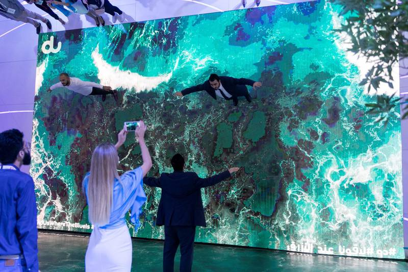 DUBAI, UNITED ARAB EMIRATES - OCTOBER 14, 2018.   Du's booth at Gitex Technology Week offered a mirror screen where visitors were able to fly across landscapes from the UAE.  (Photo by Reem Mohammed/The National)  Reporter:  Section:  NA