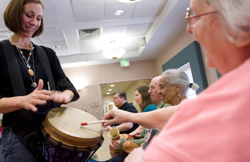 (FILES) In this file photo music therapist Heather Davidson (L) plays a drum with Claire Diering (R) during a drum circle with patients with Alzheimer's disease at the Copper Ridge Care Center in Sykesville, Maryland, on October 23, 2009. The United States on June 7, 2021 approved a drug called Aduhelm to treat patients with Alzheimer's, the first new medicine against the disease in almost two decades and the first to address cognitive decline linked to the condition. The decision was highly anticipated but also contentious, because an independent expert panel convened by the regulatory Food and Drug Administration last November found insufficient evidence of Aduhelm's benefit.  / AFP / Saul LOEB