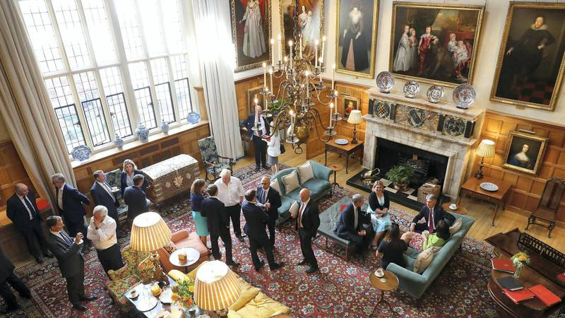 AYLESBURY, ENGLAND - JULY 06:  In this handout from the Prime Minister's Office, Prime Minister Theresa May and members of her Cabinet meet at her country retreat Chequers on July 6, 2018 in Aylesbury, England. (L-R)  Robbie Gibb, Jeremy Hunt, Michael Gove, David Davis, Liam Fox, Penny Mordaunt, Gavin Williamson, Catherine Webb, Ed de Minckwitz, Boris Johnson, Jonathan Black, Chris Grayling, Sajid Javid, Esther McVey, Jim Harra, Damian Hinds, Karen Bradley, Caroline Nokes, Philip Hammond and Claire Perry.(Photo by Joel Rouse - Crown Copyright via Getty Images)
