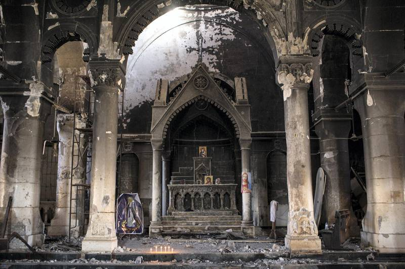 QARAQOSH, IRAQ - NOVEMBER 08: The burnt and destroyed interior of the St Mary al-Tahira church is seen on November 8, 2016 in Qaraqosh, Iraq. The NPU is a military organization made up of Assyrian Christians and was formed in late 2014 to defend against ISIL. Qaraqosh, a largely Assyrian City just 32km southeast of Mosul was taken by ISIL in August, 2014 forcing all residents to flee, the town was largely destroyed with all of the churches burned or heavily damaged. The town stayed under ISIL control last week when it was liberated during the Mosul Offensive.  (Photo by Chris McGrath/Getty Images)