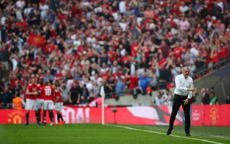 Soccer Football -  FA Cup Semi-Final - Manchester United v Tottenham Hotspur  - Wembley Stadium, London, Britain - April 21, 2018   Manchester United manager Jose Mourinho reacts as Alexis Sanchez celebrates scoring their first goal with team mates   REUTERS/Hannah McKay     TPX IMAGES OF THE DAY