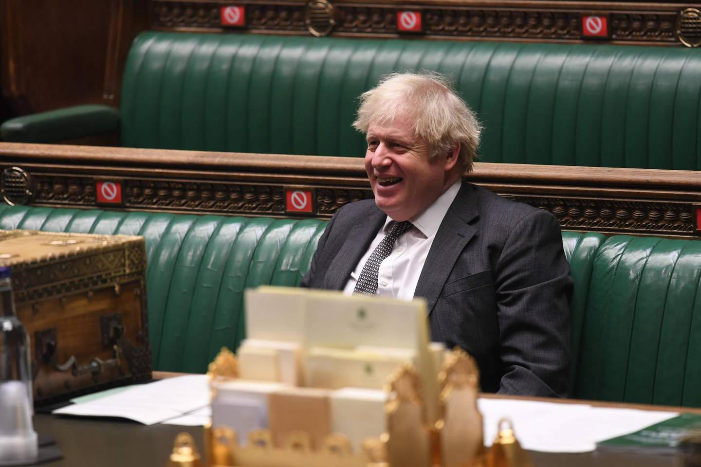 """A handout photograph released by the UK Parliament shows Britain's Prime Minister Boris Johnson smiling during the debate on the second reading of the EU Future Relationship Bill in the House of Commons in London on December 30, 2020. The lower House of Commons voted overwhelmingly by 521-73 to back it, despite serious opposition misgivings, and the bill is expected to pass the House of Lords later Wednesday in an unusually rapid procedure. - RESTRICTED TO EDITORIAL USE - NO USE FOR ENTERTAINMENT, SATIRICAL, ADVERTISING PURPOSES - MANDATORY CREDIT """" AFP PHOTO / Jessica Taylor /UK Parliament""""  / AFP / UK PARLIAMENT / JESSICA TAYLOR / RESTRICTED TO EDITORIAL USE - NO USE FOR ENTERTAINMENT, SATIRICAL, ADVERTISING PURPOSES - MANDATORY CREDIT """" AFP PHOTO / Jessica Taylor /UK Parliament"""""""