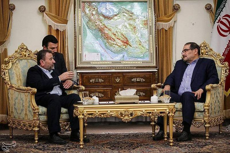 Saleh al-Arouri (L), Hamas deputy chief, meets with Ali Shamkhani, secretary of Iran's National Security Council, in Tehran, Iran October 21, 2017. Tasnim News Agency/Handout via REUTERS ATTENTION EDITORS - THIS PICTURE WAS PROVIDED BY A THIRD PARTY. NO RESALES. NO ARCHIVE.