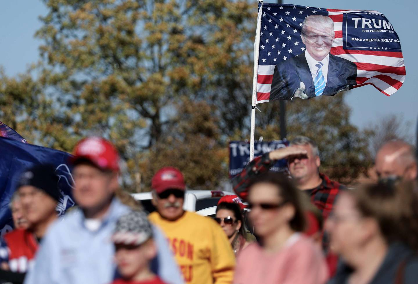 MADRID, IOWA - OCTOBER 31: A Donald Trump flag waves in the breeze as supporters of President Trump gather for a 'Trump Parade' in the battleground state of Iowa on October 31, 2020 in Madrid, Iowa. Democratic presidential nominee Joe Biden made a campaign stop in Des Moines yesterday with President Donald Trump scheduled to hold a rally in Dubuque on November 1.   Mario Tama/Getty Images/AFP == FOR NEWSPAPERS, INTERNET, TELCOS & TELEVISION USE ONLY ==