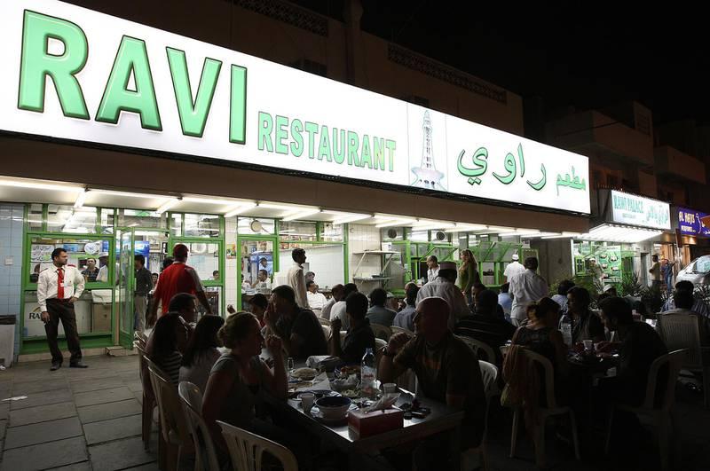 DUBAI, UNITED ARAB EMIRATES – Mar 24: People enjoying food in the evening at Ravi restaurant in Al Satwa in Dubai. (Pawan Singh / The National) For Personal Finance. Story by Daniel Bardsley  *** Local Caption ***  PS07- RAVI RESTAURANT.jpg