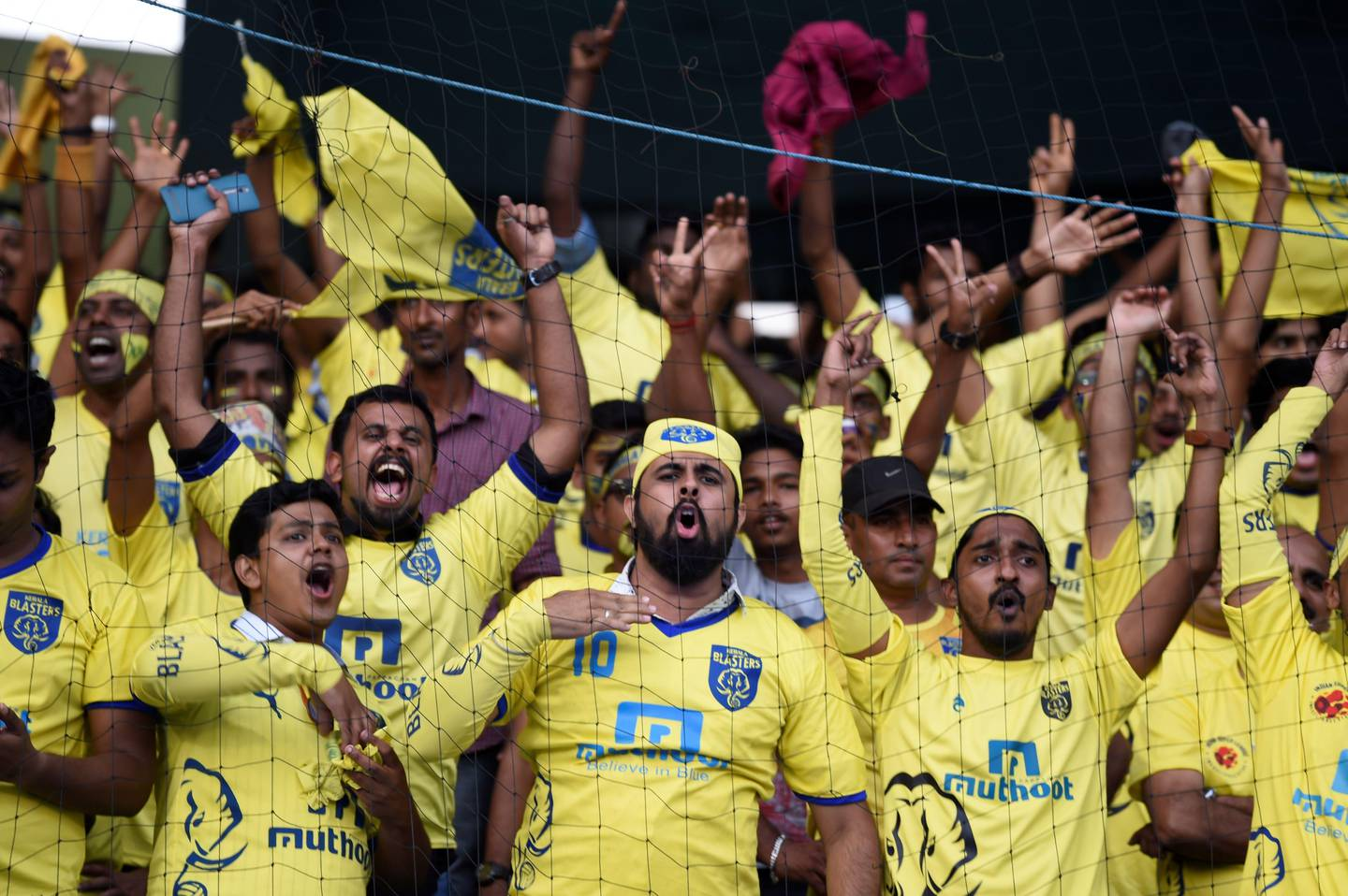 (FILES) This file photo taken on December 18, 2016 shows Kerala Blasters FC supporters cheering before the final Indian Super League (ISL) football match Between Kerala Blasters FC and Atletico de Kolkata at the Jawahar Lal Nehru Stadium in Kochi. The Indian Super League has slashed the number of high-earning foreign stars for its new season starting Friday but foreign coaches, including ex-England heroes Teddy Sheringham and Steve Coppell, will be in charge of every team. / AFP PHOTO / SAJJAD HUSSAIN