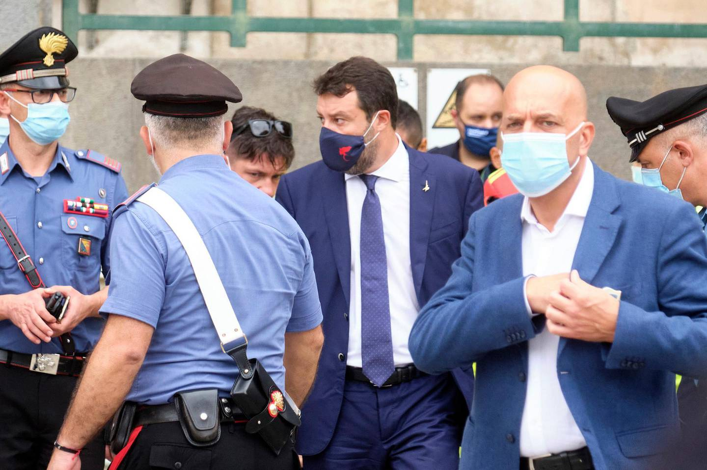 The League's leader Matteo Salvini, center wearing a face mask, leaves after a hearing in court in the Sicilian city of Catania, southern Italy, Saturday, Oct. 3, 2020. Italy's right-wing former interior minister Salvini, appeared Saturday before a court in Sicily that will decide whether he will face trial for blocking 131 migrants for several days on a coast guard ship in 2019.  (Mauro Scrobogna/LaPresse via AP)