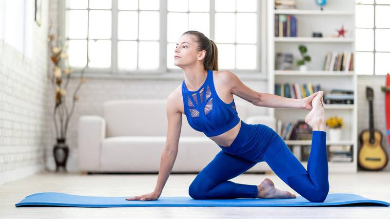 Young sporty attractive woman practicing yoga, Horse rider exercise
