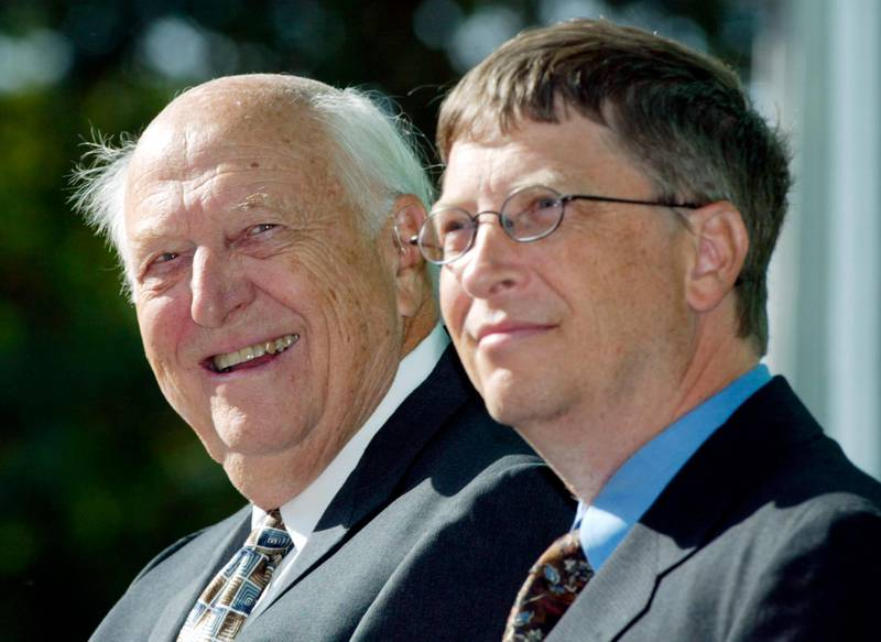 FILE - In this Sept. 12, 2003 file photo, William H. Gates Sr., left, smiles while sitting next to his son, Bill Gates Jr., during the dedication and grand opening of the William H. Gates Hall, new home of the University of Washington School of Law in Seattle. Bill Gates Sr., a lawyer and philanthropist and father of Microsoft co-founder Bill Gates, died Monday, Sept. 14, 2020, at age 94. (AP Photo/John Froschauer, File)