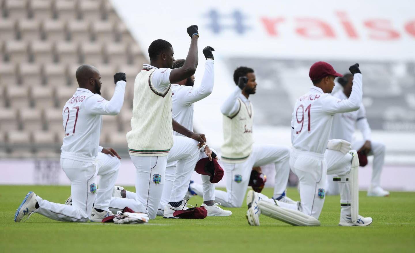 Cricket - First Test - England v West Indies - Rose Bowl Cricket Stadium, Southampton, Britain - July 8, 2020   West Indies players kneel in support of the Black Lives Matter campaign before the match , as play resumes behind closed doors following the outbreak of the coronavirus disease (COVID-19)   Mike Hewitt/Pool via REUTERS