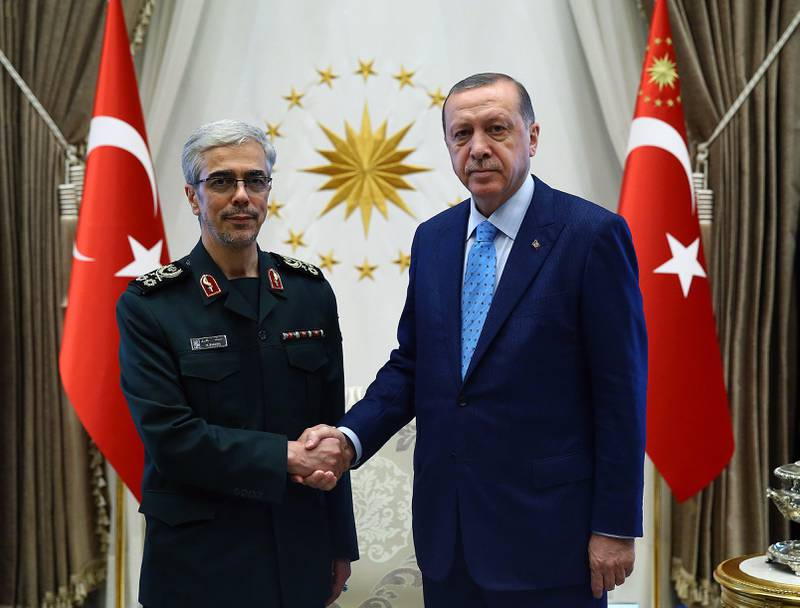 epa06147442 A handout photo made available by the Turkish President Press Office shows Turkish President Recep Tayyip Erdogan (R) with Iran's Major General Mohammad Bagheri (L) as they shake hands during their meeting in Ankara, Turkey, 16 August 2017.  EPA/TURKISH PRESIDENT PRESS OFFICE HANDOUT  HANDOUT EDITORIAL USE ONLY/NO SALES