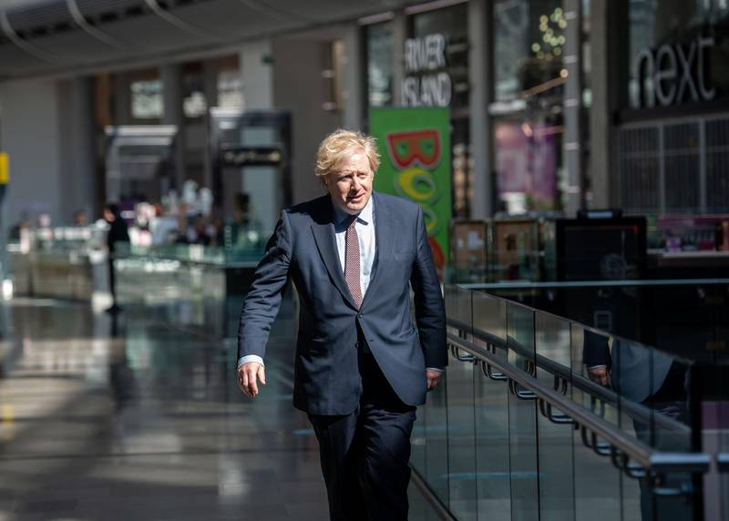 Prime Minister Boris Johnson visits the M&S clothing department and other retail outlets in Westfield Stratford to see the COVID-19 measure taken before reopening tomorrow, in London, Britain June 14, 2020. John Nguyen/Pool via REUTERS