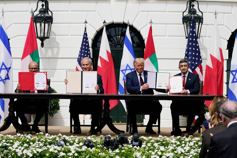 FILE - In this Sept. 15, 2020, file photo, from left; Bahrain Foreign Minister Khalid bin Ahmed Al Khalifa, Israeli Prime Minister Benjamin Netanyahu, U.S. President Donald Trump, and United Arab Emirates Foreign Minister Abdullah bin Zayed al-Nahyan, sit during the Abraham Accords signing ceremony on the South Lawn of the White House, in Washington. As Israel heads to the polls next week for the fourth time in two years, Prime Minister Benjamin Netanyahu has sought to capitalize on his new partnership with the United Arab Emirates in his desperate campaign to stay in power. (AP Photo/Alex Brandon, File)