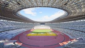 Wooden canopies, 60,000 capacity and special cooling roof: $1.4bn Tokyo Olympics stadium officially completed - in pictures