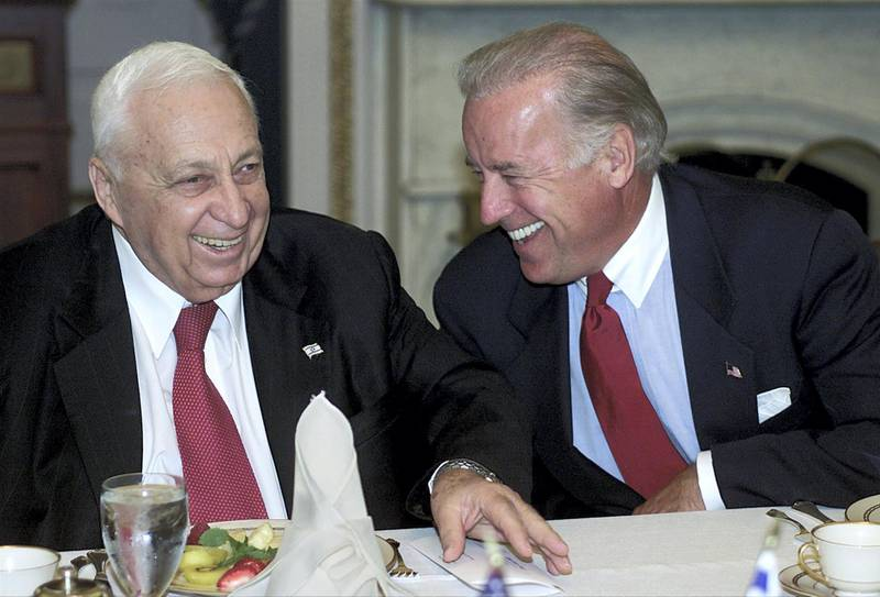 Israel's Prime Minister Ariel Sharon (L) laughs with Chairman of the Senate Foreign Relations Senator Joe Biden (R) during a meeting at the US Capitol 11 June 2002. Sharon is visiting Capitol Hill to thank members of both houses of Congress for their support for Israel and his policies.    AFP Photo/Stephen JAFFE (Photo by STEPHEN JAFFE / AFP)