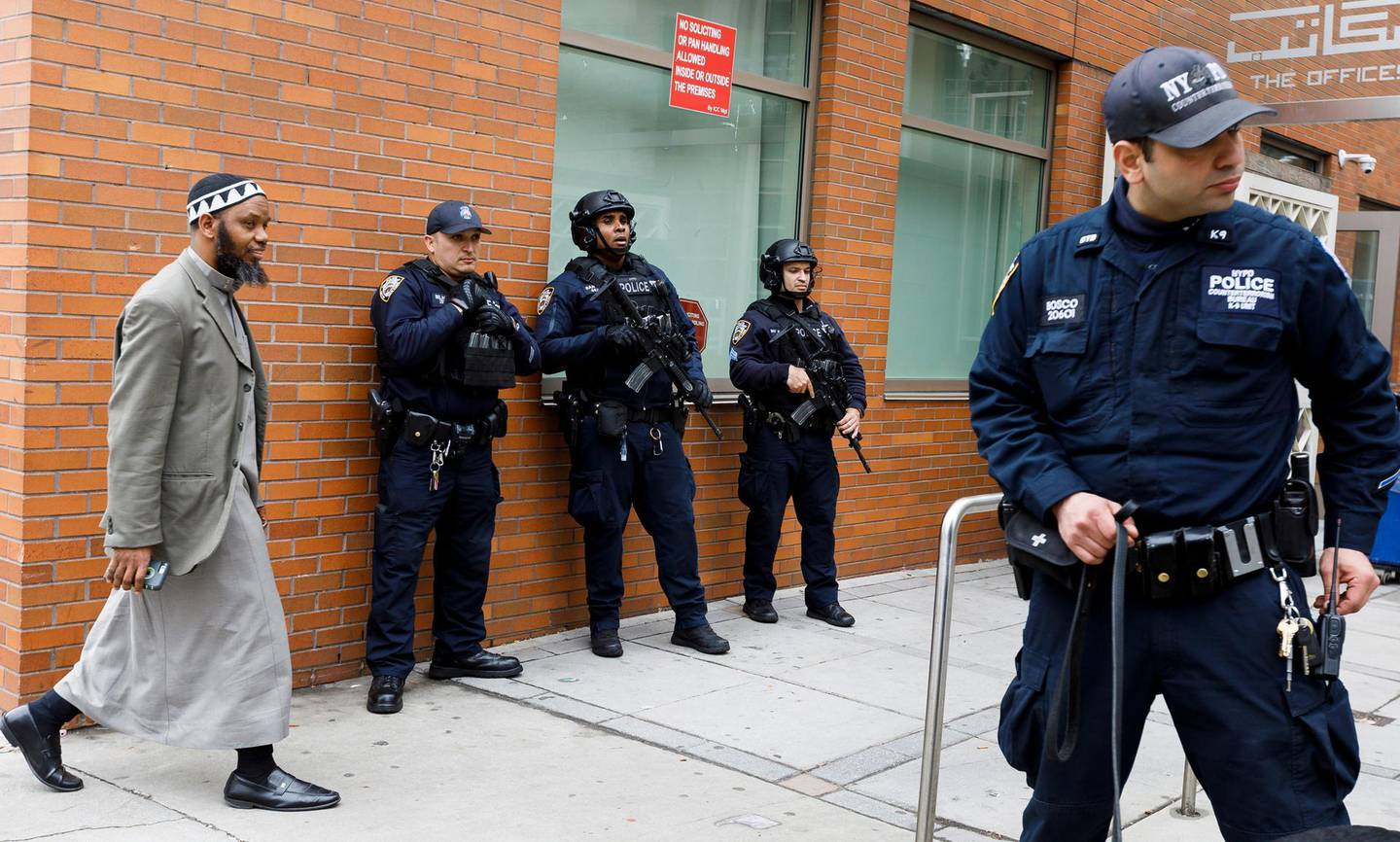 epa07440470 New York City police officers, including officers from the department's Counterterrorism Unit, provide security at the Islamic Cultural Center of New York as people arrive for Friday prayers in New York, New York, USA, 15 March 2019. Security in New York, and at sites around the world, was heightened following what was described as terrorist attacks at two mosques in New Zealand where 49 people were killed by a gunman and 20 more injured and in critical conditions.  EPA/JUSTIN LANE