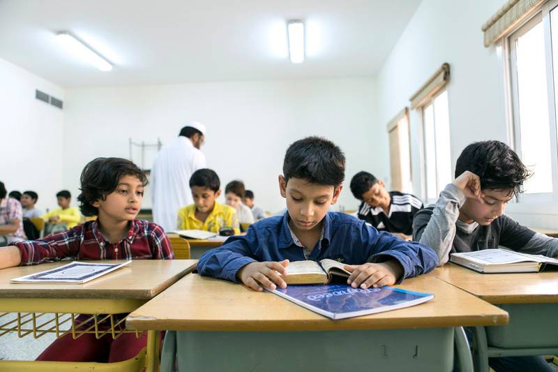 DUBAI, UNITED ARAB EMIRATES, March 20, 2015. Students at Level 5 classroom in Al Manar Quran Study Center. Level 5 is the highest in the center, where excelling students from all age groups are brought together.  Photo: Reem Mohammed / The National   *** Local Caption ***  RM_20150320_QURAN_012.jpg