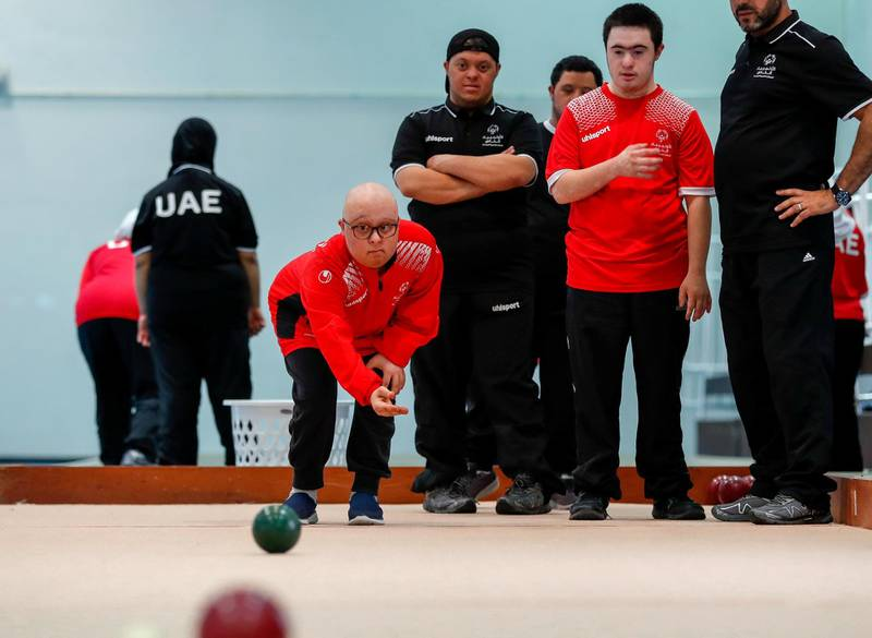 Al Ain, UAE, March 8, 2018.  UAE Special Olympics team training sessions.  UAE BOCCE Team.  Mahmoud Jaharoo throws the ball as his team mates watch on.Victor Besa / The NationalNationalReporter; Ramola Talwar