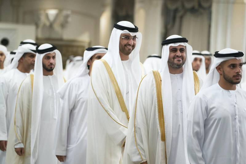 ABU DHABI, UNITED ARAB EMIRATES - June 15, 2018: HH Sheikh Theyab bin Mohamed bin Zayed Al Nahyan, Chairman of the Department of Transport, and Abu Dhabi Executive Council Member (2nd R) and HE Dr Sultan Ahmed Al Jaber, UAE Minister of State, Chairman of Masdar and CEO of ADNOC Group (3rd R), attend an Eid Al Fitr reception at Mushrif Palace.    ( Mohamed Al Hammadi / Crown Prince Court - Abu Dhabi ) ---