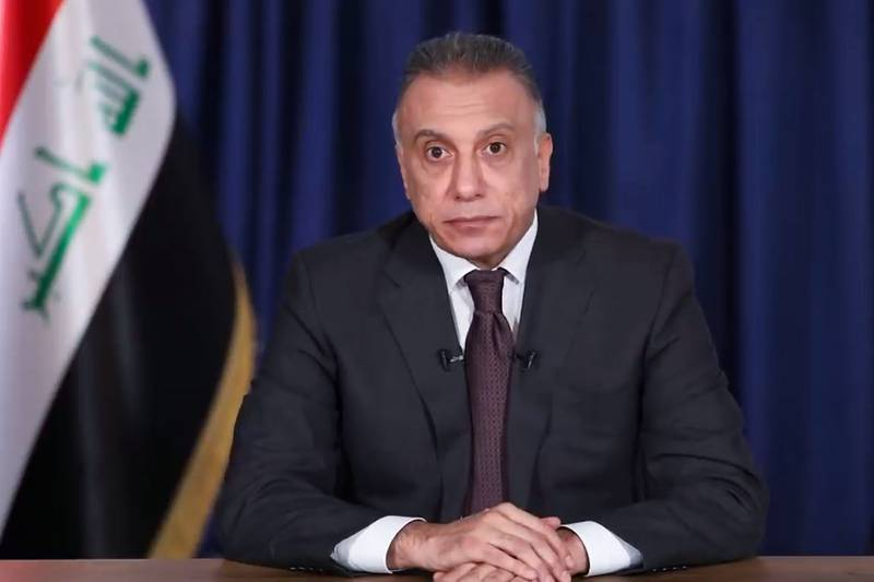 """An image grab from a handout video released by the Iraqi Prime Minster's Office shows Prime Minister-designate Mustafa Kadhemi addressing the Iraqi people in a televised speech in the capital Baghdad, on April 9, 2020. Iraqi President nominated 53-year-old spy chief Kadhemi on April 9 as the country's third prime minister-designate this year, moments after his predecessor ended his bid to form a government, amid a budget crisis brought on by the collapse in world oil prices and the spread of the novel coronavirus. - RESTRICTED TO EDITORIAL USE - MANDATORY CREDIT """"AFP PHOTO /IRAQI PRIME MINISTER'S OFFICE """" - NO MARKETING - NO ADVERTISING CAMPAIGNS - DISTRIBUTED AS A SERVICE TO CLIENTS  / AFP / IRAQI PRIME MINISTER'S OFFICE / - / RESTRICTED TO EDITORIAL USE - MANDATORY CREDIT """"AFP PHOTO /IRAQI PRIME MINISTER'S OFFICE """" - NO MARKETING - NO ADVERTISING CAMPAIGNS - DISTRIBUTED AS A SERVICE TO CLIENTS"""