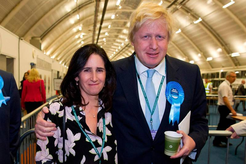 (FILES) In this file photo taken on May 08, 2015 London Mayor and Conservative Party parliamentary candidate for Uxbridge and Ruislip South, Boris Johnson (R) and his wife Marina Wheeler (L) pose after winning his seat in Uxbridge, west London in the British general election. - Britain's former foreign secretary Boris Johnson, who is tipped as a future prime minister, revealed on September 7, 2018 that he has separated from his wife and the couple are getting a divorce. (Photo by Justin TALLIS / AFP)