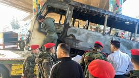 Bomb attack on military bus in Damascus kills 14