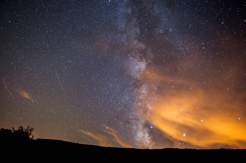 epaselect epa06141758 Two meteorite of the swarm of meteorites Perseida burn up in the atmosphere next to the Milky Way early 13 August 2017, over San Miguel de Aguayo, Spain. The Perseid meteor shower occurs every year in summer when the Earth passes through debris and dust of the 109P/Swift-Tuttle comet. The Perseids, one of the brightest meteorite swarms, consist of a multitude of stellar particles which due to their high speed glow up and burn by entering Earth's atmosphere.  EPA/PEDRO PUENTE HOYOS