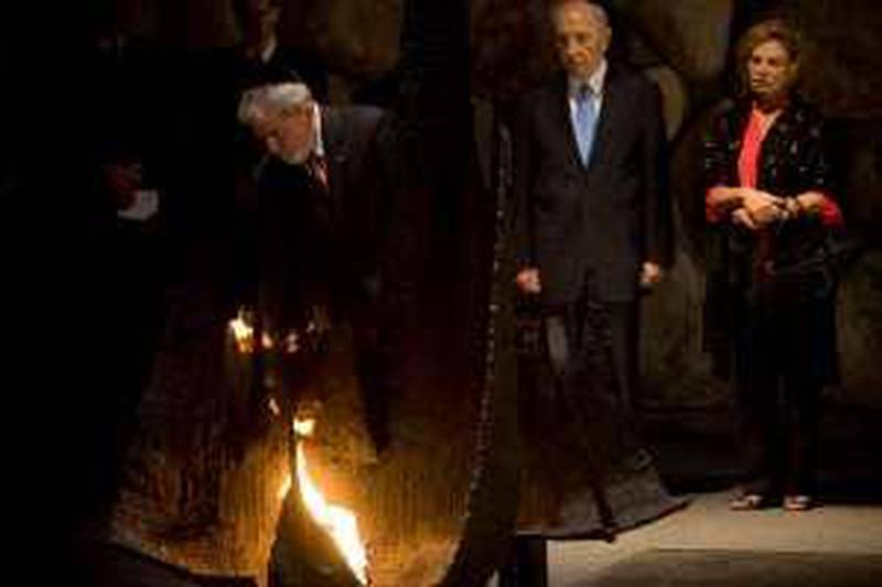 Brazilian President Luiz Inacio Lula da Silva rekindles the Eternal flame at the Hall of Remembrance at the Yad Vashem Holocaust Museum in Jerusalem, Tuesday, March 16, 2010. Brazil's president made a case Monday for playing a larger role in Mideast diplomacy, despite Israel's deep discomfort with his opposition to sanctions against Iran over its nuclear program. (AP Photo/Bernat Armangue) *** Local Caption ***  JRL104_MIDEAST_ISRAEL_PALESTINIANS_BRAZIL.jpg
