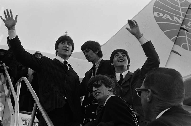 The Beatles wave at the crowd while in the US for their first US concerts, February 1964; clockwise, John Lennon (1940 - 1980), George Harrison (1943 - 2001), Paul McCartney, and Ringo Starr. (Photo by Daily Express/Hulton Archive/Getty Images)