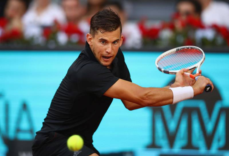 MADRID, SPAIN - MAY 11:  Dominic Thiem of Austria plays a backhand against Rafael Nadal of Spain in their quarter final match during day seven of the Mutua Madrid Open tennis tournament at the Caja Magica  on May 11, 2018 in Madrid, Spain.  (Photo by Clive Brunskill/Getty Images)