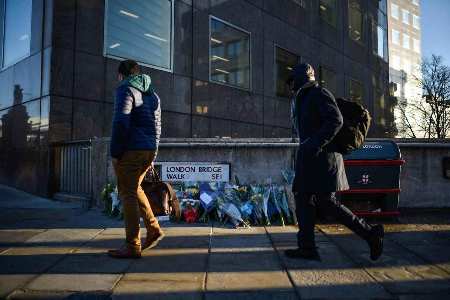 LONDON, ENGLAND - DECEMBER 02: Floral tributes are left for Jack Merritt and Saskia Jones, who were killed in a terror attack, on December 2, 2019 in London, England. Usman Khan, a 28 year old former prisoner convicted of terrorism offences, killed two people in Fishmongers' Hall at the North end of London Bridge on Friday, November 29, before continuing his attack on the bridge. Mr Khan was restrained and disarmed by members of the public before being shot by armed police. (Photo by Peter Summers/Getty Images)