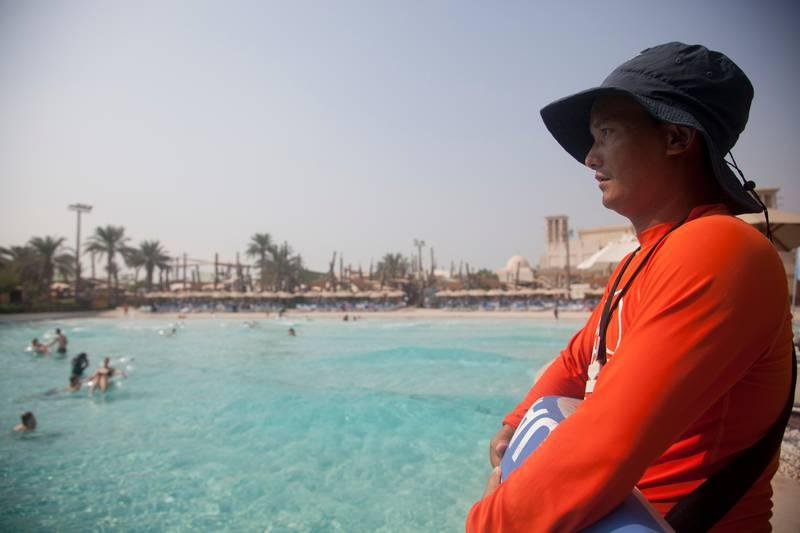 Abu Dhabi, United Arab Emirates - September 16 2015 - Bir Tamang, a Nepalese lifeguard poses for a photo by the wave pool at Yas WaterWorld. Reporter: Gillian Duncan. Section: Business. (Razan Alzayani for The National)  *** Local Caption ***  RA20150916_YasLifeguard_11.jpg RA20150916_YasLifeguard_11.jpg