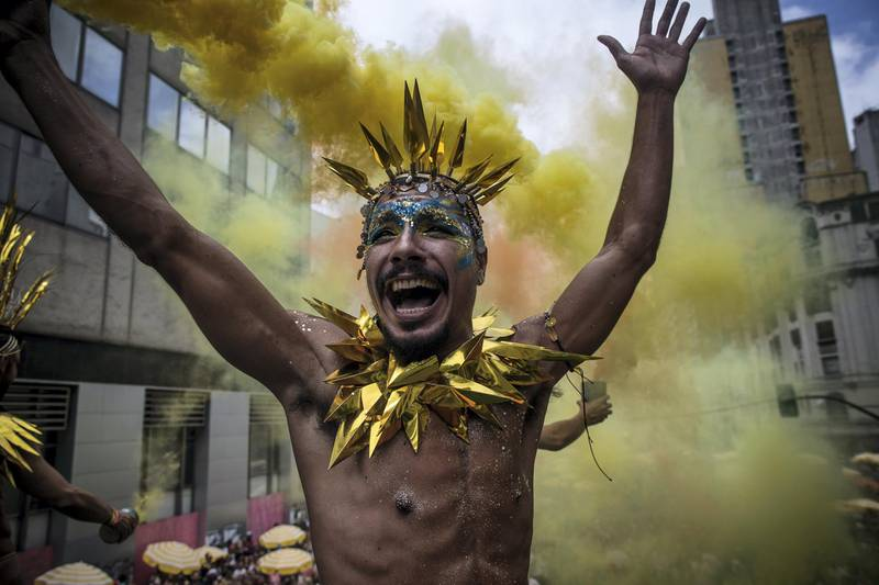 """SAO PAULO, BRAZIL - MARCH 02: Revellers participate in the Carnival group """"Bloco Tarado Ni Você"""" parade honoring the brazilian singer Caetano Veloso through the streets of downtown on March 2, 2019, in São Paulo, Brazil.  (Photo by Victor Moriyama/Getty Images)"""